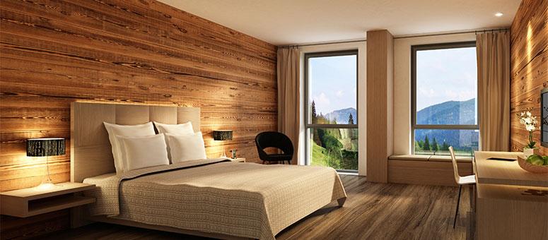 Schlafzimmer mit Holzwänden in den Bergen